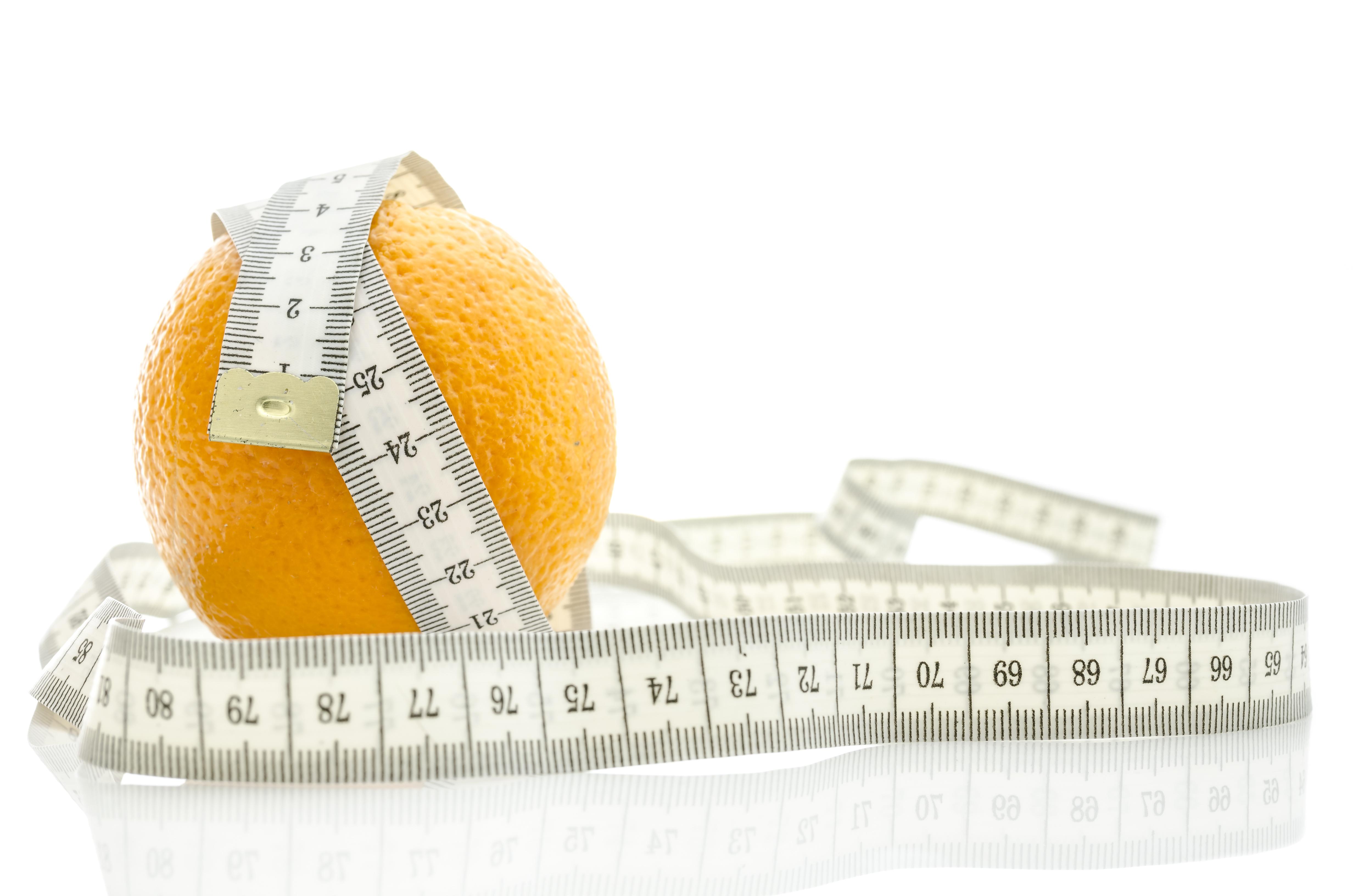 Fresh orange with measuring tape